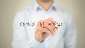 Cambi il mondo, scrittura dell'uomo sullo schermo trasparente Fotografia Stock Libera da Diritti