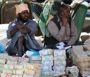 Cambiadores de dinero de la calle del dinero Imagen de archivo libre de regalías