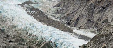 Cambiamento di clima, ghiaccio del ghiacciaio di fusione e roccia pura Immagine Stock