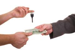 Cambie el clave al dinero Fotografía de archivo libre de regalías