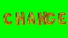 Cambio de la palabra de las letras del globo del oro del helio que flotan en la pantalla verde - metrajes