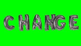 Cambio de la palabra de las letras de plata del globo del helio que flotan en la pantalla verde - almacen de metraje de vídeo