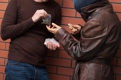 Cambio de las drogas para el dinero Fotografía de archivo libre de regalías