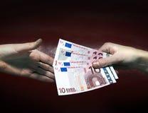 Cambio del dinero Fotos de archivo libres de regalías