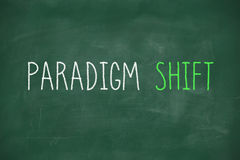Cambio del paradigma manuscrito en la pizarra Fotografía de archivo libre de regalías