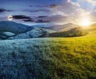 Cambios del tiempo sobre prado herboso en montañas fotografía de archivo