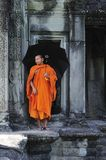 Cambodia Angkor wat gallery with a monk Stock Photo