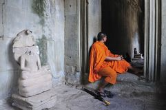 Cambodia Angkor Wat with a monk Stock Photos