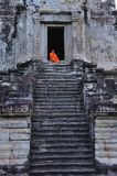 Cambodia Angkor Wat with a monk royalty free stock photo