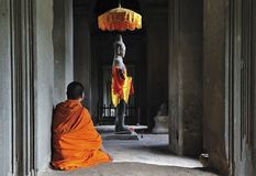 Cambodia Angkor Wat time to pray Royalty Free Stock Images