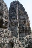 Bayon is remarkable for the 216 serene and smiling stone faces on the many towers jutting out from the high terrace and cluster stock photo