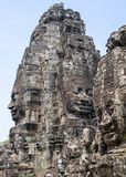 Bayon is remarkable for the 216 serene and smiling stone faces on the many towers jutting out from the high terrace and cluster royalty free stock images