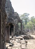 Bayon is remarkable for the 216 serene and smiling stone faces on the many towers jutting out from the high terrace and cluster royalty free stock photography