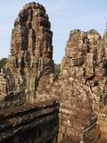 Cambodia Bayon Temple stone smiling human faces. Travel ancient khmer Royalty Free Stock Photos