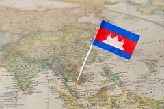 Cambodia flag on a map. Cambodia paper flag pin on a map. Officially known as the Kingdom of Cambodia is a country located in the southern portion of the stock images
