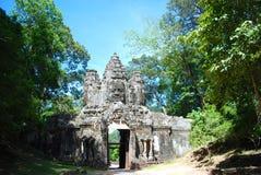 Cambodia  gate to  temple. Cambodia bluebird day la prong temple  person gateway faces Stock Image