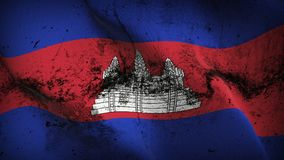 Cambodia grunge dirty flag waving on wind. Cambodian background fullscreen grease flag blowing on wind. Realistic filth fabric texture on windy day Royalty Free Stock Image