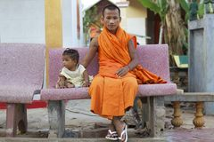 Cambodia Monk with Baby Royalty Free Stock Photos