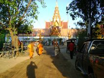 Cambodia religious temple monks trees religious gathering. Cambodia religious temple monks walking towards trees and religious gathering in the distant stock photos