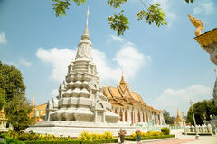 Cambodia Royal Palace, Silver Pagoda and stupa. View of the stupa and the silver pagoda at the background Royalty Free Stock Image