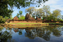 Cambodia. Siem Reap. Angkor. Banteay Srey temple. And the lake with lotuses Stock Photos