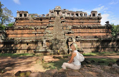 Cambodia. Siem Reap. Angkor Tom. Khmer pyramid. Cambodia. Siem Reap. Angkor Tom. Pyramid of Phimeanakas temple. Girl is sitting on the sandstone blocks Royalty Free Stock Photos