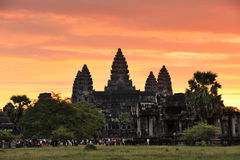 Cambodia. Siem Reap. Awaking Angkor wat temple. Against the colourful fiery sunrise sky. Crowds of tourists are meeting the sunrise Stock Image