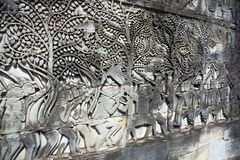 Cambodia. Siem Reap. Carved stone patterns on temple walls.  stock photos