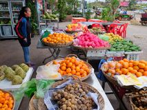 Cambodia, Siem Reap 12/08/2018 young Asian girl sells fruit on a city street stock photo