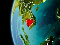Cambodia from space in evening. Evening over Cambodia as seen from space on planet Earth with visible border lines and city lights. 3D illustration. Elements of Royalty Free Stock Photography