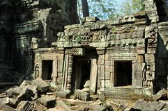 Cambodia - Ta Prohm temple. Angkor Wat, Siem Reap area (Cambodia) - Ta Prohm temple, also called Tomb Raider temple, where silk-cotton trees are consuming the royalty free stock photography