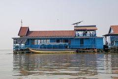 Floating church and school house. Children play on the upper storey between their lessons royalty free stock photo