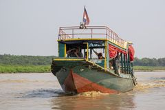 River bus serving the community at the floating town in Tonle-Sap stock photo