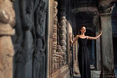 Cambodia Tourist Attraction. Happy Woman In Angkor Wat Temple. Royalty Free Stock Photo