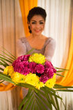 Cambodian Asian Girl Holding Bouquet of Flowers Stock Photos