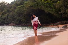 Cambodian Asian Woman Walking Along the Beach. Cambodian Girl Walking Along the Beach by the Ocean in the Early Morning stock photos