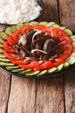 Cambodian beef Lok Lak with fresh vegetables and a side dish of Stock Images