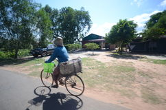 Cambodian on bicycles Stock Images
