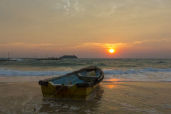 Cambodian boat during sunrise on the beach of Koh Rong Island Royalty Free Stock Images