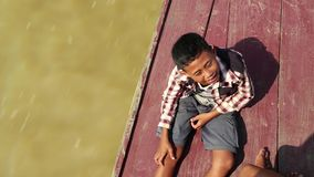 Cambodian boy on the boat which sails to the Tonle Sap lake in Cambodia stock footage