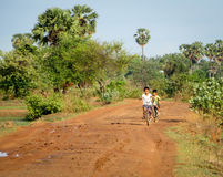 Cambodian Boys Riding Bike Royalty Free Stock Images