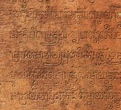 Cambodian calligraphy. On ancient stone Stock Photos