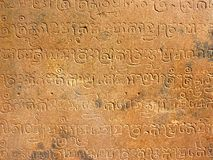 Cambodian calligraphy in Angkor Wat. Photo taken inside the Angkor Wat temple in Combodia. Detail of combodian calligraphy on a wall Royalty Free Stock Photo