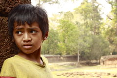 Cambodian child waiting for tourists at Angkor Wat Royalty Free Stock Photo
