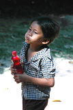 Cambodian Child. A Cambodian child young boy kid drinking water Stock Images