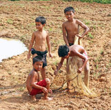 Cambodian Children. Shirtless Cambodian children holding a fishing net in Siem Reap, Cambodia Royalty Free Stock Photography
