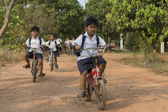 Cambodian Children on bike. Kampot, Cambodia Stock Photos