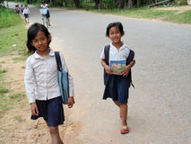 Cambodian children going to school. Cambodian children with books and bags going to school, People living in Cambodia. South east Asia Stock Photo