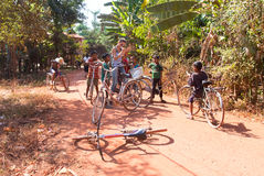 Cambodian children. PHNOM PENH, CAMBODIA - JANUARY 05 2015: Cambodian children are students going to classes at the school on bicycles Stock Images