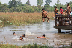 Cambodian children are playing water. Together. They are so fun with their time Royalty Free Stock Photography